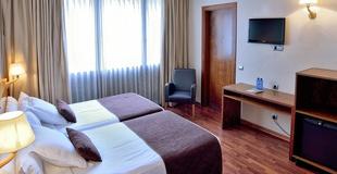 STANDARD-DREIBETTZIMMER HLG CityPark Pelayo Hotel